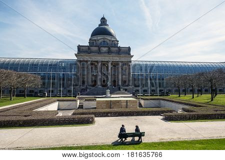 Munich Bavaria Germany.- March 28, 2017. View of the facade of the Chancellery of the State of Bavaria (Bayerische Staatskanzlei) and War memorial in the courtyard Kriegerdenkmal im Hofgarten