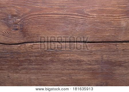 vintage varnished wooden table planks separated by big gap