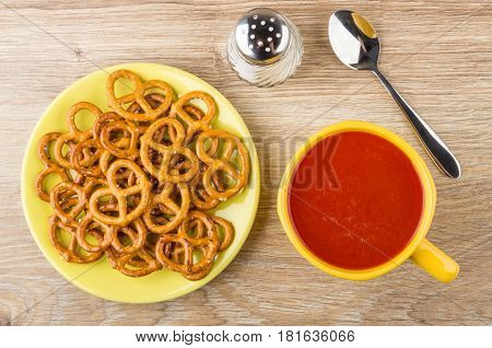 Salted Pretzels In Saucer, Salt, Tomato Juice In Cup