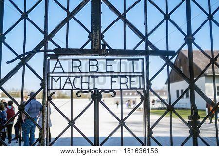 Dachau Bavaria Germany.- March 28 2017. work sets you free sign on gates at Dachau Concentration Camp