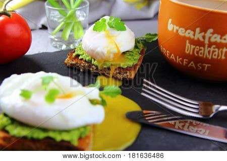 avocado toast with poached egg,micro greens and a Cup of coffee