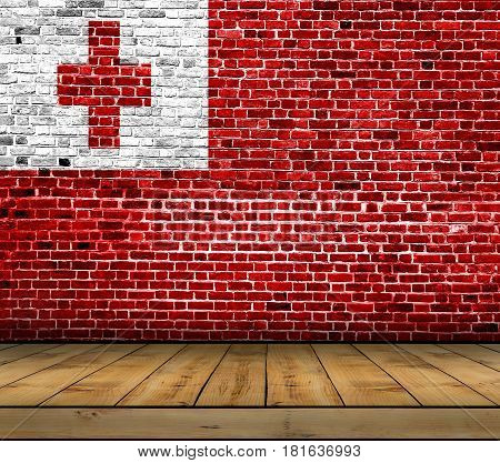 Tonga flag painted on brick wall with wooden floor