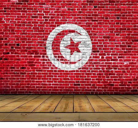 Tunisia flag painted on brick wall with wooden floor