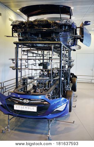 MOSCOW - APR, 16, 2016: Blue car with inscription Ensemble dividing on parts in Hyundai Motorstudio. Hyundai invited owners Hyundai Solaris to MotorStudio celebrate record sales