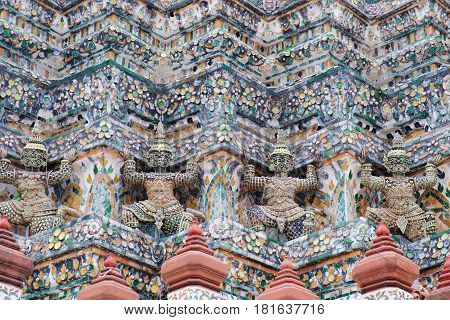 Demon Guardian Statues at pagoda of Temple of Dawn, Wat Arun, Bangkok, Thailand. Magnificent Architecture of Wat Arun