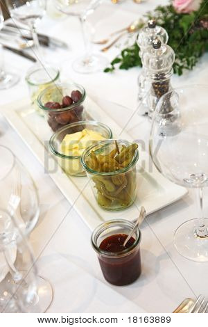 Tapas And Appetizers, Olives And Butter On The Table