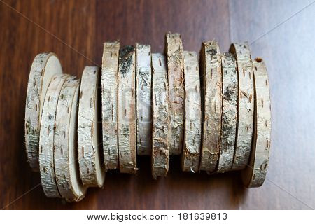 Cut Trunk Or Trunk Slices With Bark. Birch Wooden Round Circles Cut As Sausage On Wooden Background