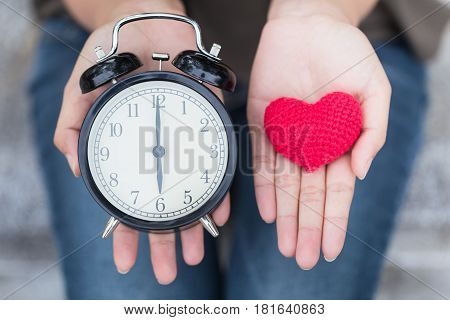 Give Time With Love, Showing Retro Clock And Red Heart On Hand.