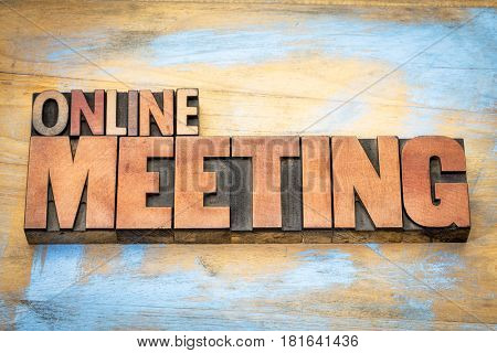 online meeting word in letterpress wood type against grunge wooden background