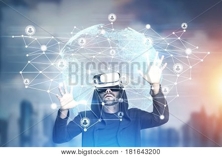 African American man in vr glasses looking at a network sketch and the Earth in a city. Toned image double exposure.