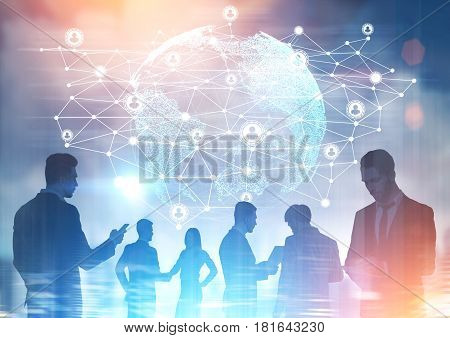 Close up of businesspeople silhouettes are seen against a network sketch and the Earth hologram in the sky. Toned image double exposure.