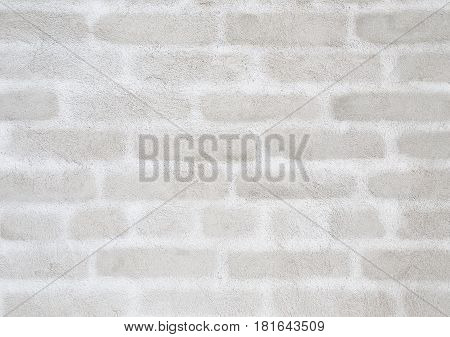Plastered wall on which silhouettes of bricks are seen. Building background.
