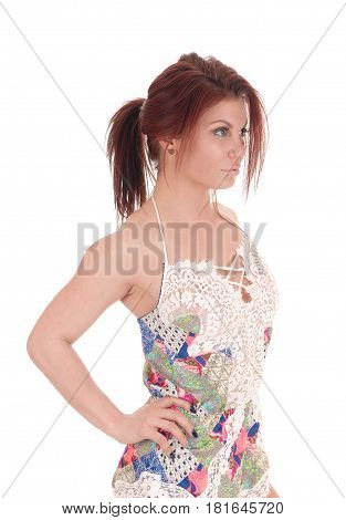 A beautiful young woman standing in a gorgeous baby doll night gown with brunette hair isolated for white background.