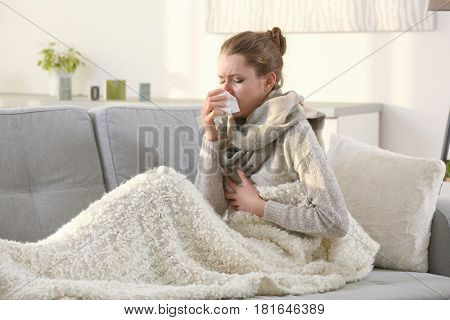 Ill girl sitting on couch at home