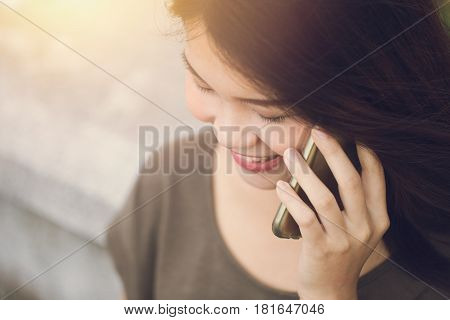 Asian women enjoy on phone call teen calling using smartphone.