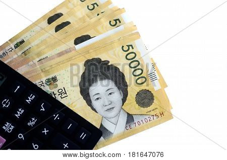 Calculator And South Korean Currency 50000 Korean Won On White Background With Copy Space