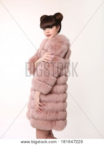 Brunette Smiling Teen Girl In Pink Fur Coat, Young Stylish Beautiful Woman Isolated On Studio White