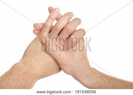 Hands of young man suffering from pain in fingers on white background