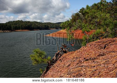 Clay shores of Lake Hiwassee reveal low water conditions of the reservoir near Murphy, North Carolina