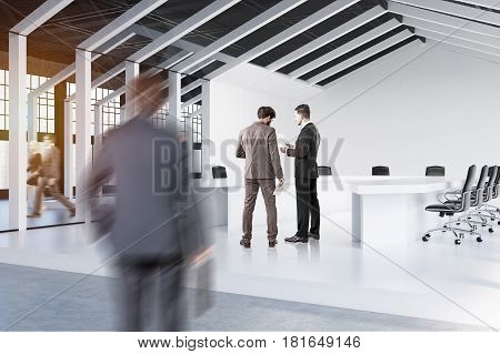 Corner of a house framed conference room with a white floor and walls and three tables with chairs around them. People are walking around. 3d rendering.