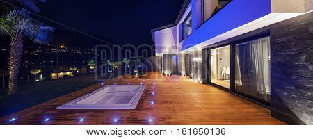 Exteriors of modern luxury villa in the night