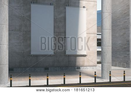 Vertical Posters On Concrete Building