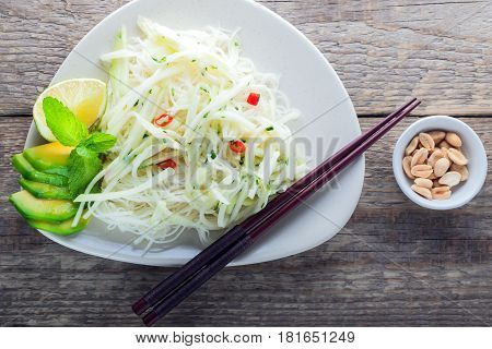 Spicy kohlrabi noodles, dressing: fish sauce, vinegar rices, lime garlic and ginger