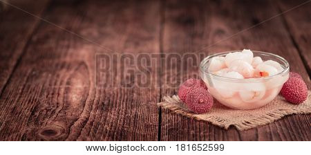 Preserved Lychees (selective Focus) On Vintage Wooden Background