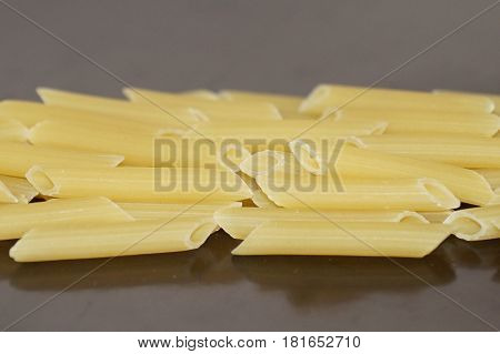 Pasta, pasta, isolated on a black background. Raw pasta. Flour food. Italian Cuisine.