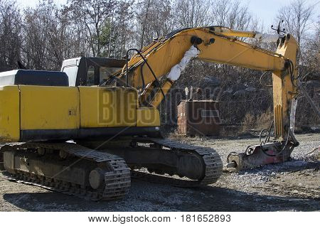 Granite quarry. Excavator in quarry. Quarry landscape