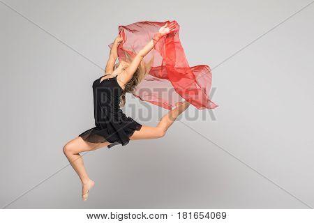 Beautiful Gymnastics Dancer On Aerial Silk In Studio On White Background.