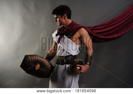 The handsome gladiator is prepared for battle.