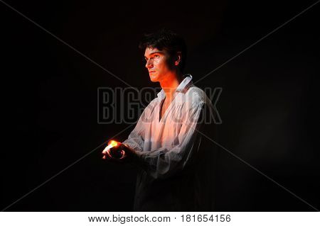 The handsome man is holding a light.