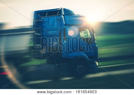 Semi Truck Euro Transportation. Speeding Semi on the Highway. Cargo and Shipping Theme.