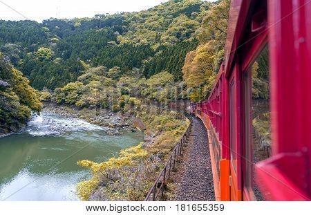 Beautiful mountain landscape and Hozu River seen from Sagano Scenic Railway or romantic train in Arashiyama Japan