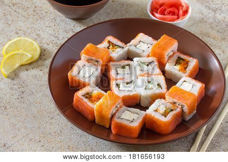 Sushi Set On A Stone Background - Roll Philadelphia Classic, Roll Cheese Salmon And Roll Jamaica Wit