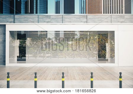Empty glass shopfront in daylight. Advertisement concept. Mock up 3D Rendering