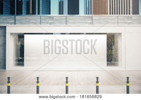 Empty glass storefront with balnk white banner in daylight. Commercial concept. Mock up 3D Rendering