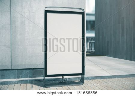 Blank white poster outside. Concrete building in the background. Retail concept. Mock up 3D Rendering