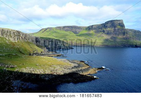 Gorgeous sun shining on the landscape of Neist Point on the Isle of Skye in Scotland.