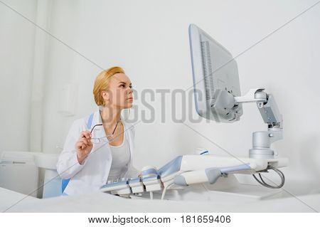 Doctor Analyze The Result Of Ultrasound Diagnostic Machine