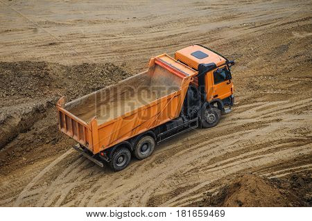 Truck Working Hard At The Site