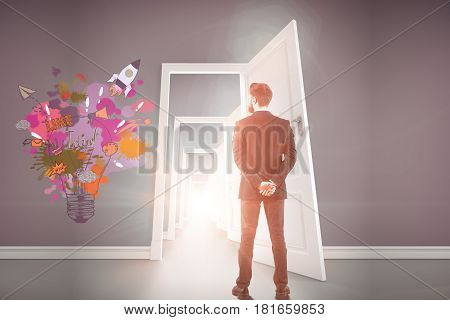 Back view of young businessman in abstract concrete interior with multiple doors and rocket sketch. Creative startup ideas concept. 3D Rendering