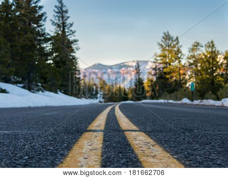 Low Angle View of Stripes on Snowy Mountain Road