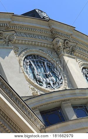 Architectural detail of the Romanian Athenaeum from Bucharest.Under the roof is the name of Beethoven.