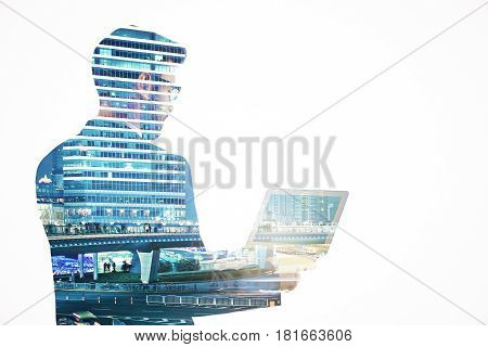 Side view of young businessman using laptop on abstract night city background. Communication concept. Double exposure