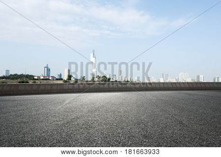 cityscape of nanjing from empty asphalt road