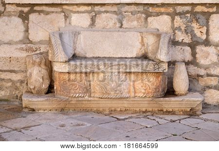 KORCULA, CROATIA - NOVEMBER 09: A stone bench in front of the Bishop's Treasury in the Old Town of Korcula, Dalmatia, Croatia on November 09, 2016.
