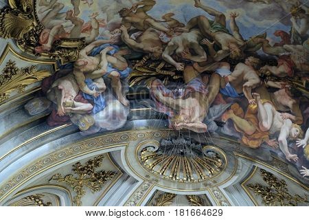 ROME, ITALY - SEPTEMBER 04: The ceiling fresco of The Fall of the Rebelious Angels in church dei Santi XII Apostoli in Rome, Italy on September 04, 2016.