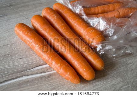 Orange carrot pictures ready to cut with carrot, knife in the package